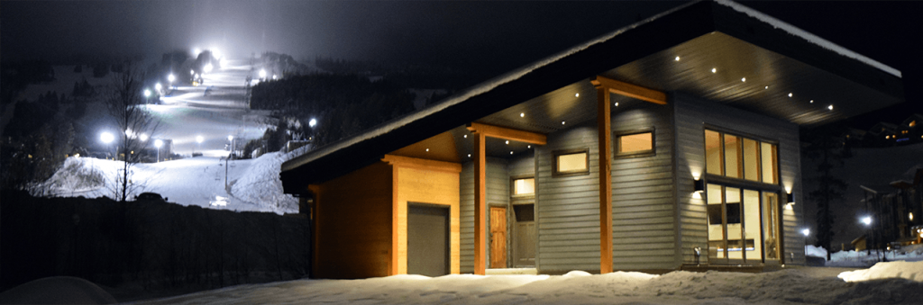 Energy Step Code How it Works Header - photo of residential building exterior at night